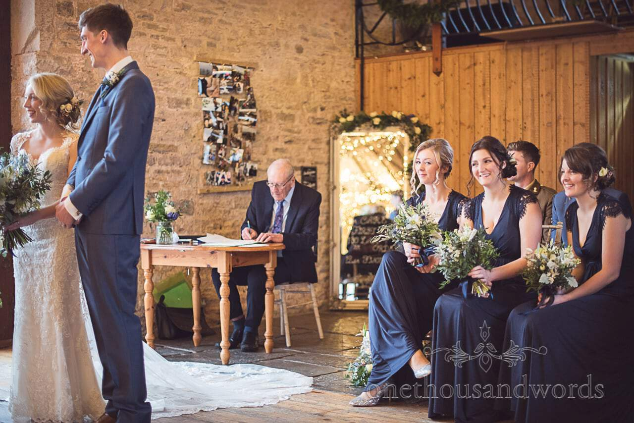 Cheeky bridesmaids in navy blue at Kingston Country Courtyard wedding venue