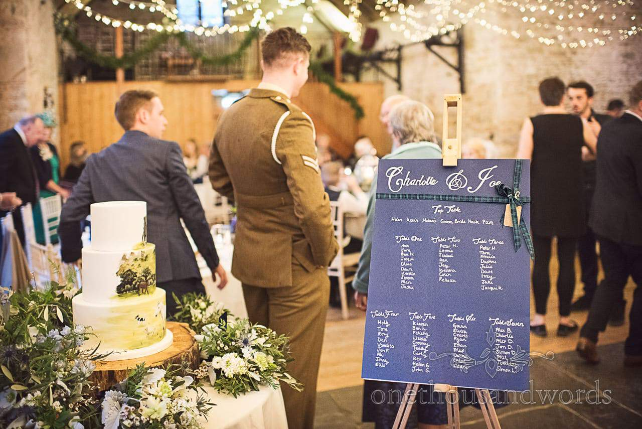 Custom made blue wedding table plan gold writing on wooden artists easel