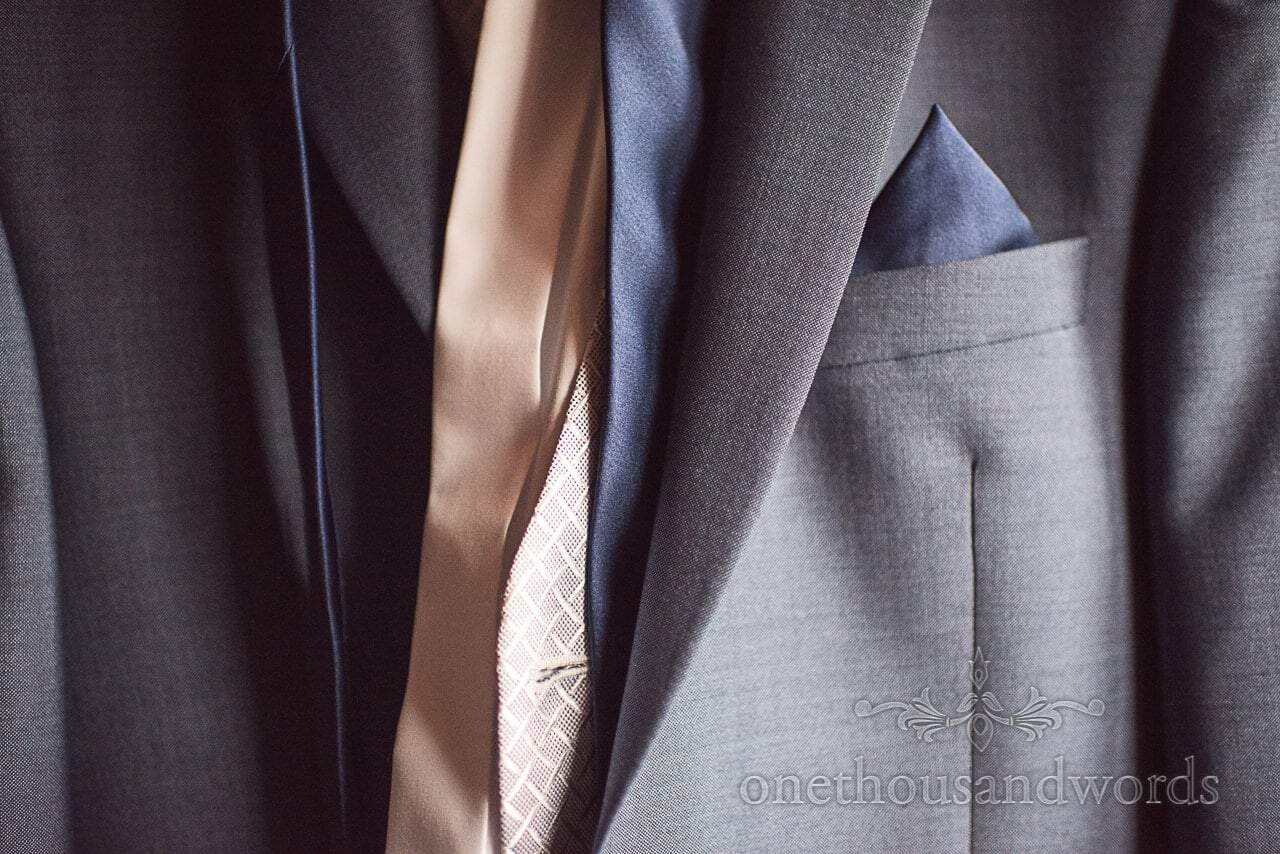 Detail wedding photograph of blue wedding suit with pocket square and waistcoat