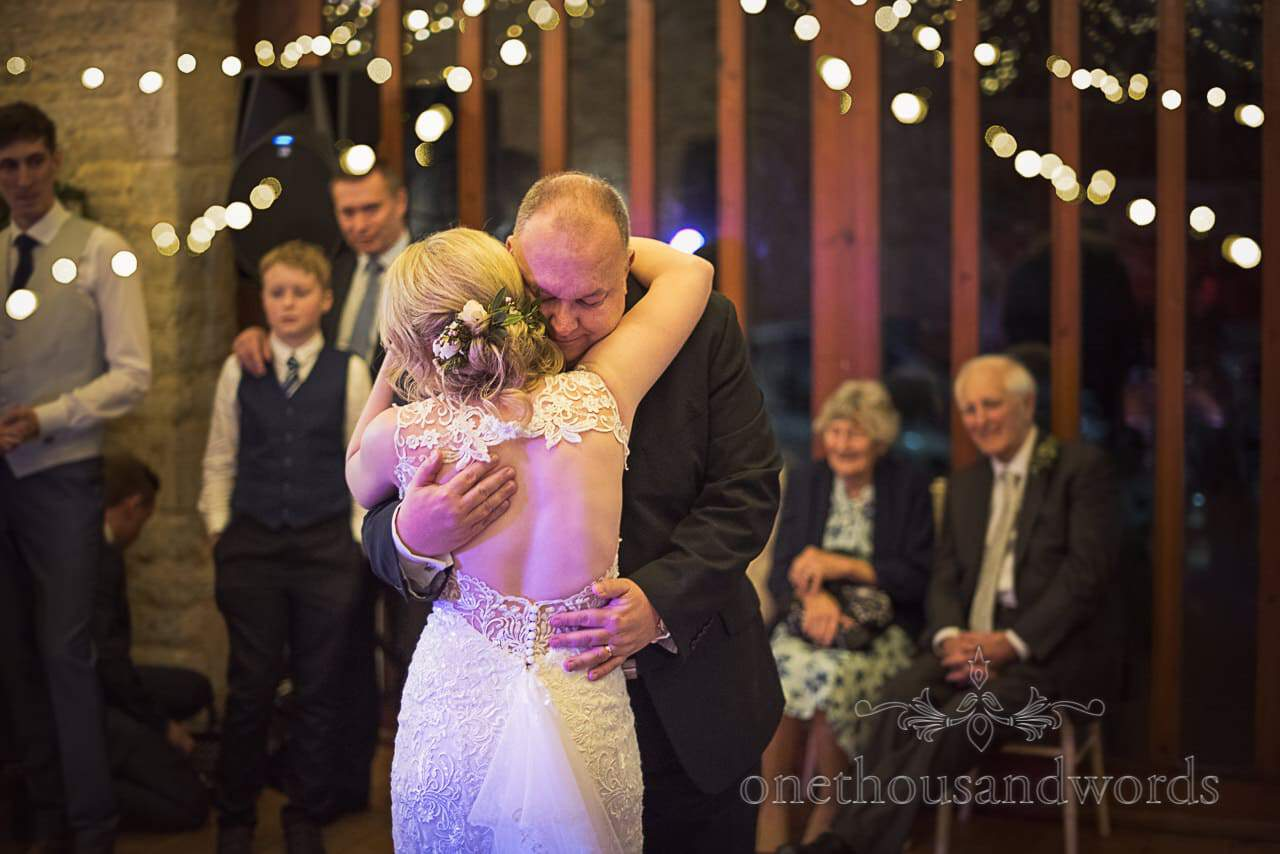 Father and daughter dance under fairy lights at Kingston Country Courtyard