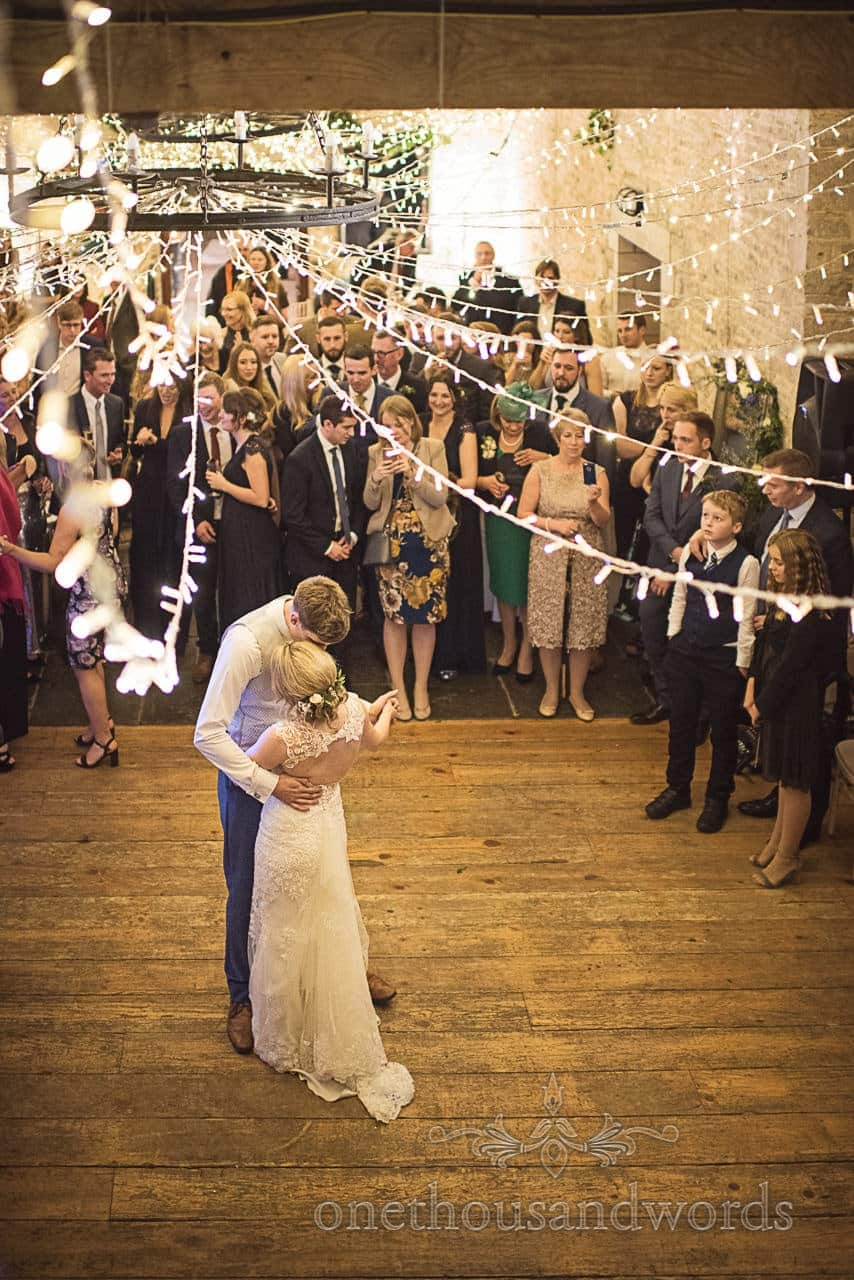 First dance with wedding fairy lights at Dorset Courtyard Wedding barn