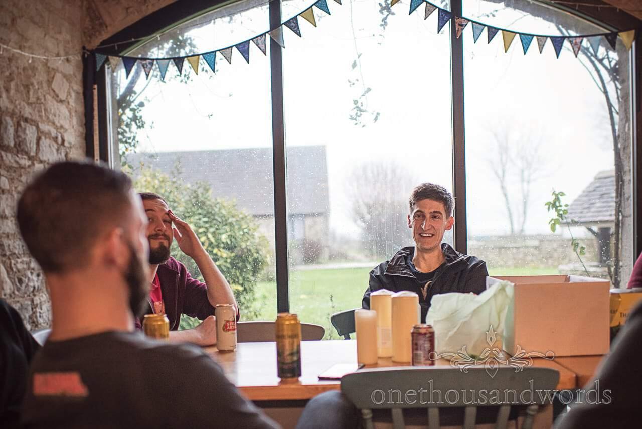 Groom and groomsmen enjoy a boozy breakfast on wedding morning