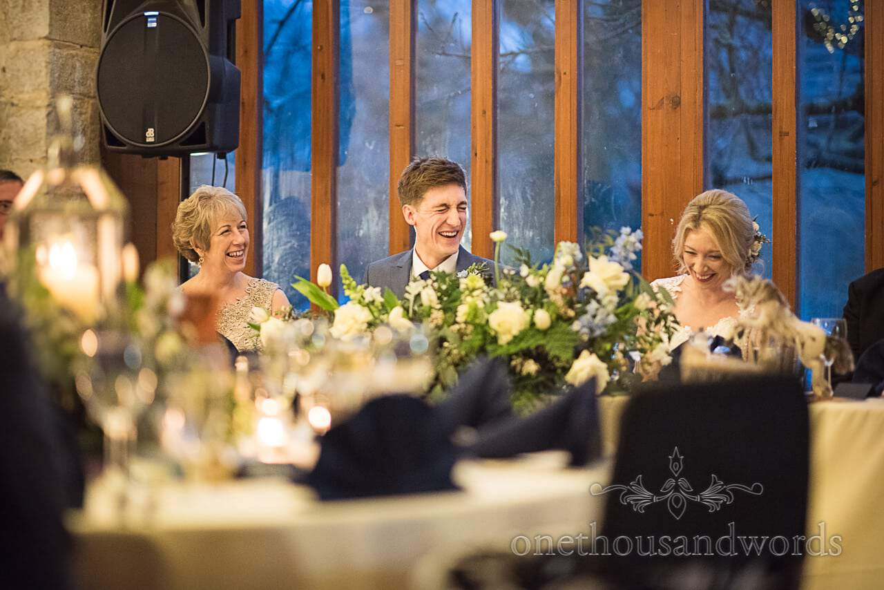 Groom laughs at Dorset Courtyard wedding venue speeches by one thousand words