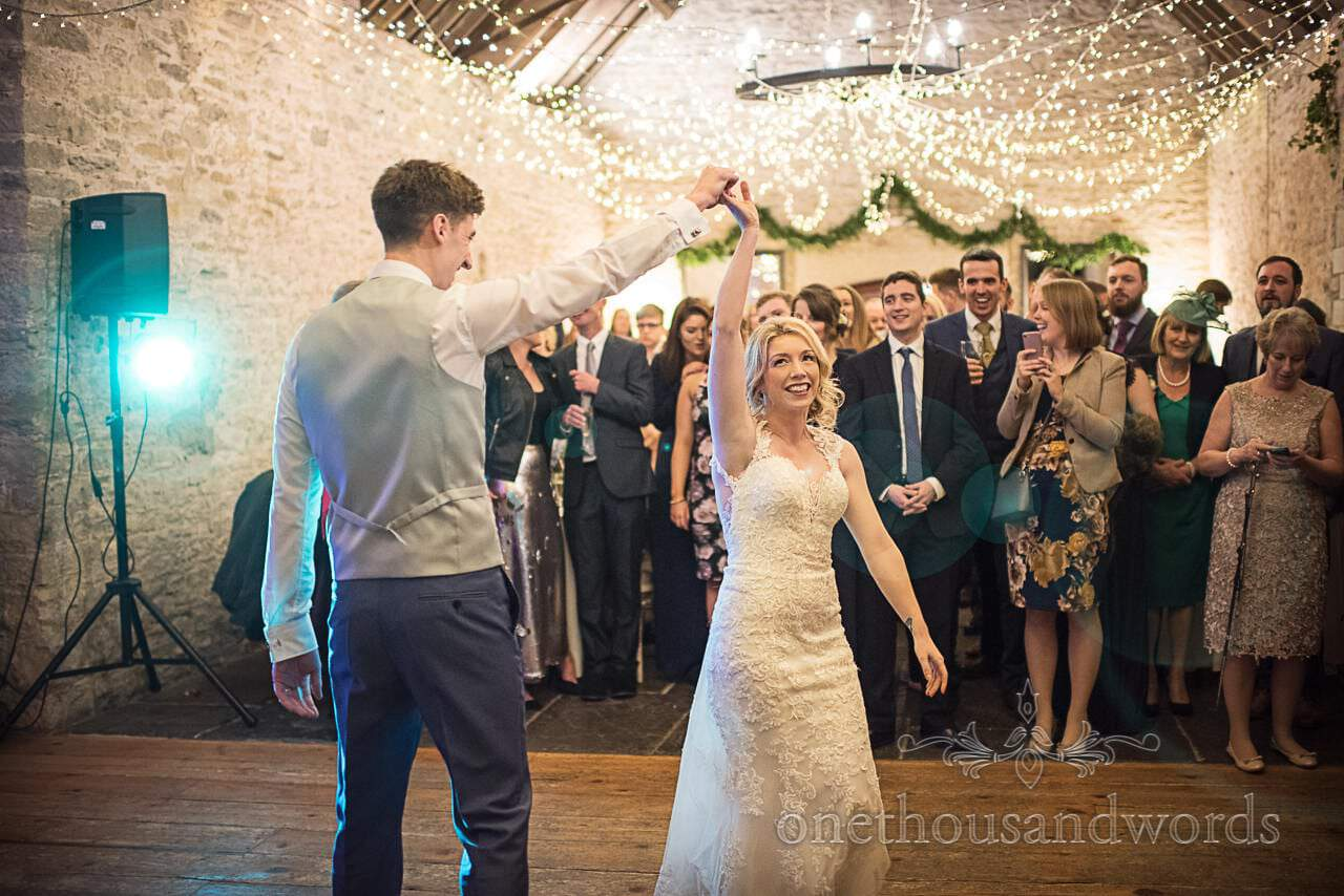 Happy bride first dance wedding photograph at Kingston Country Courtyard venue