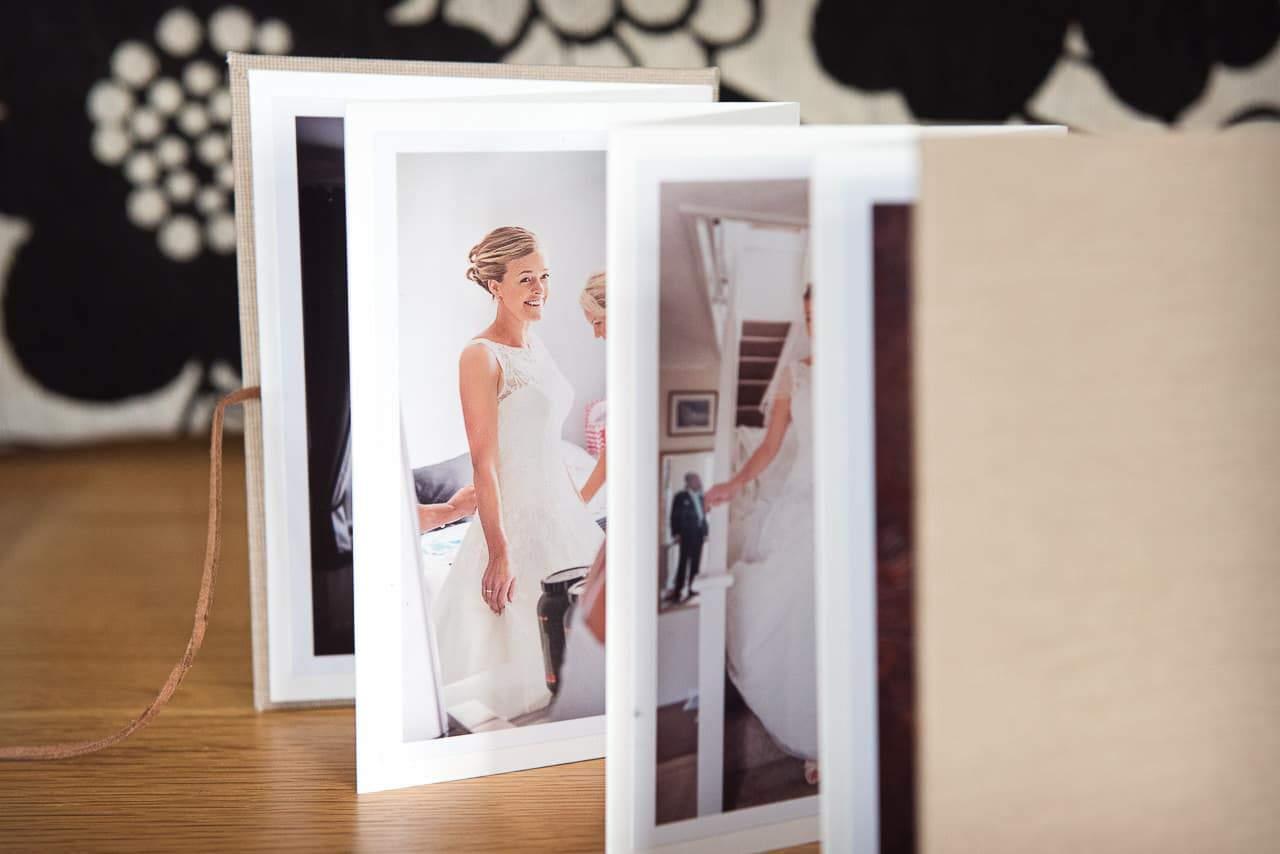 Linen accordion album photograph of happy bride wedding photography services