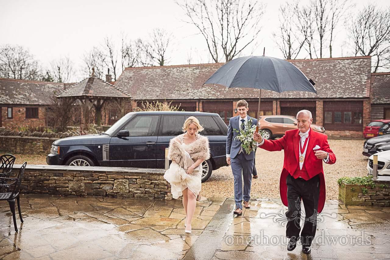 Mike Judd wedding MC escorts bride and groom rain at Kingston Country Courtyard