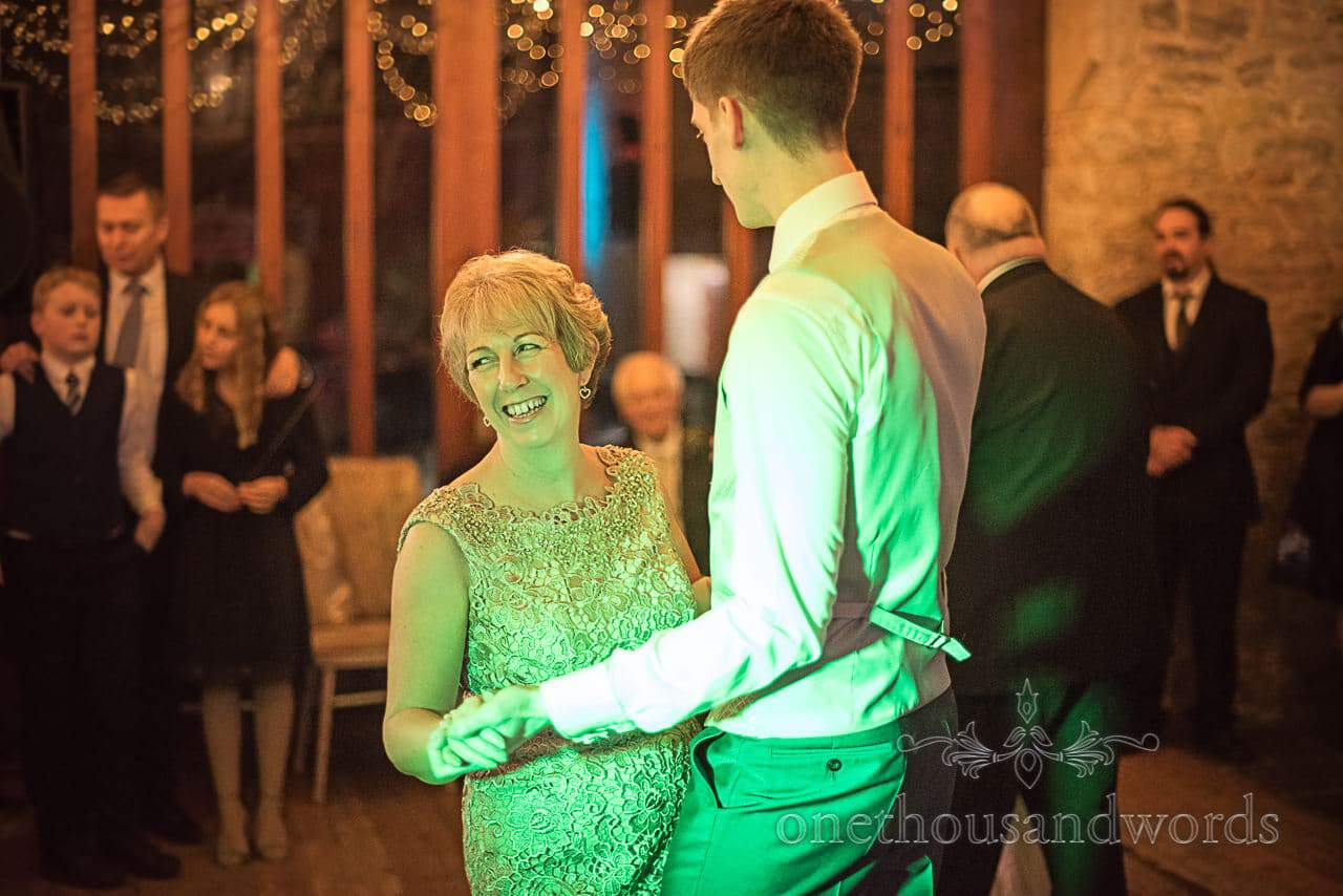 Mother of the bride dances with groom at Dorset Courtyard wedding venue