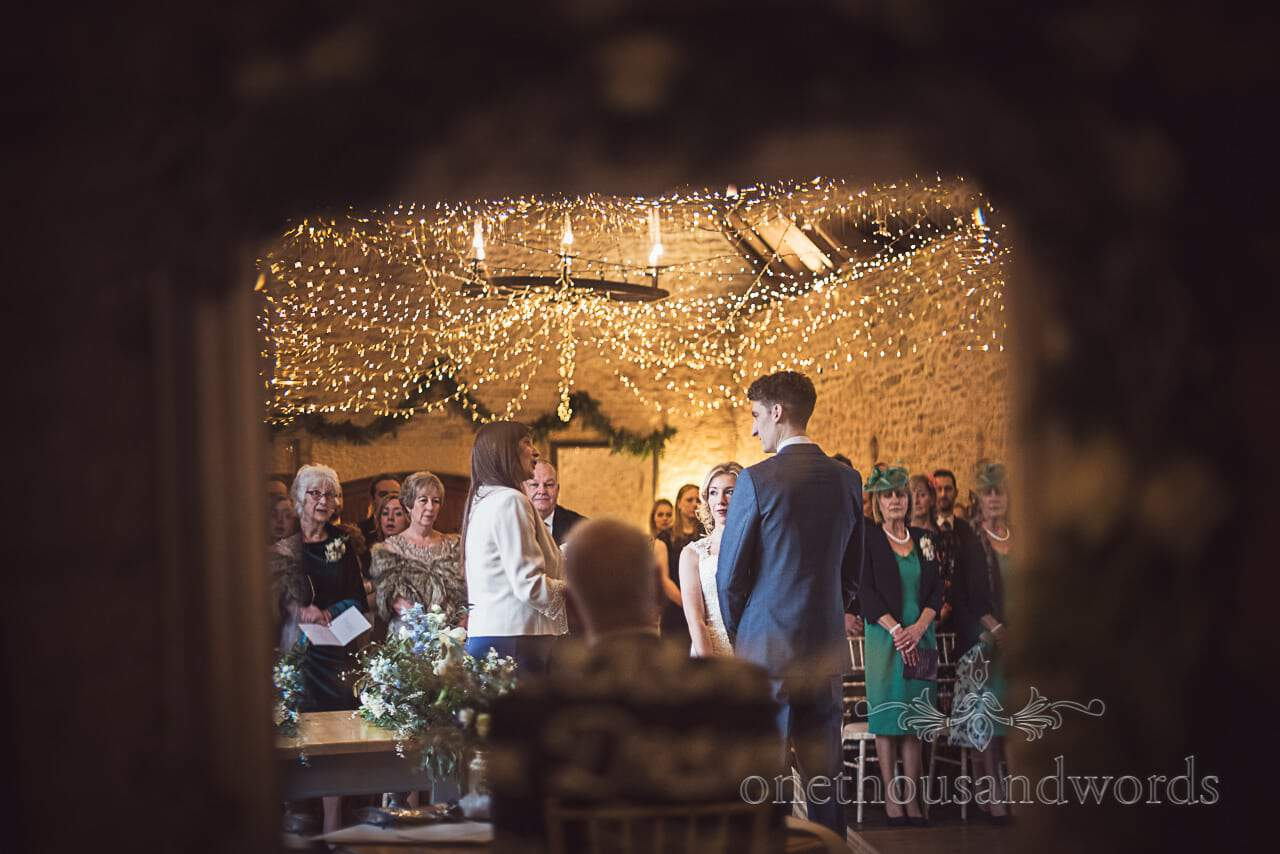 Reflection in mirror of Kingston Country Courtyard wedding ceremony