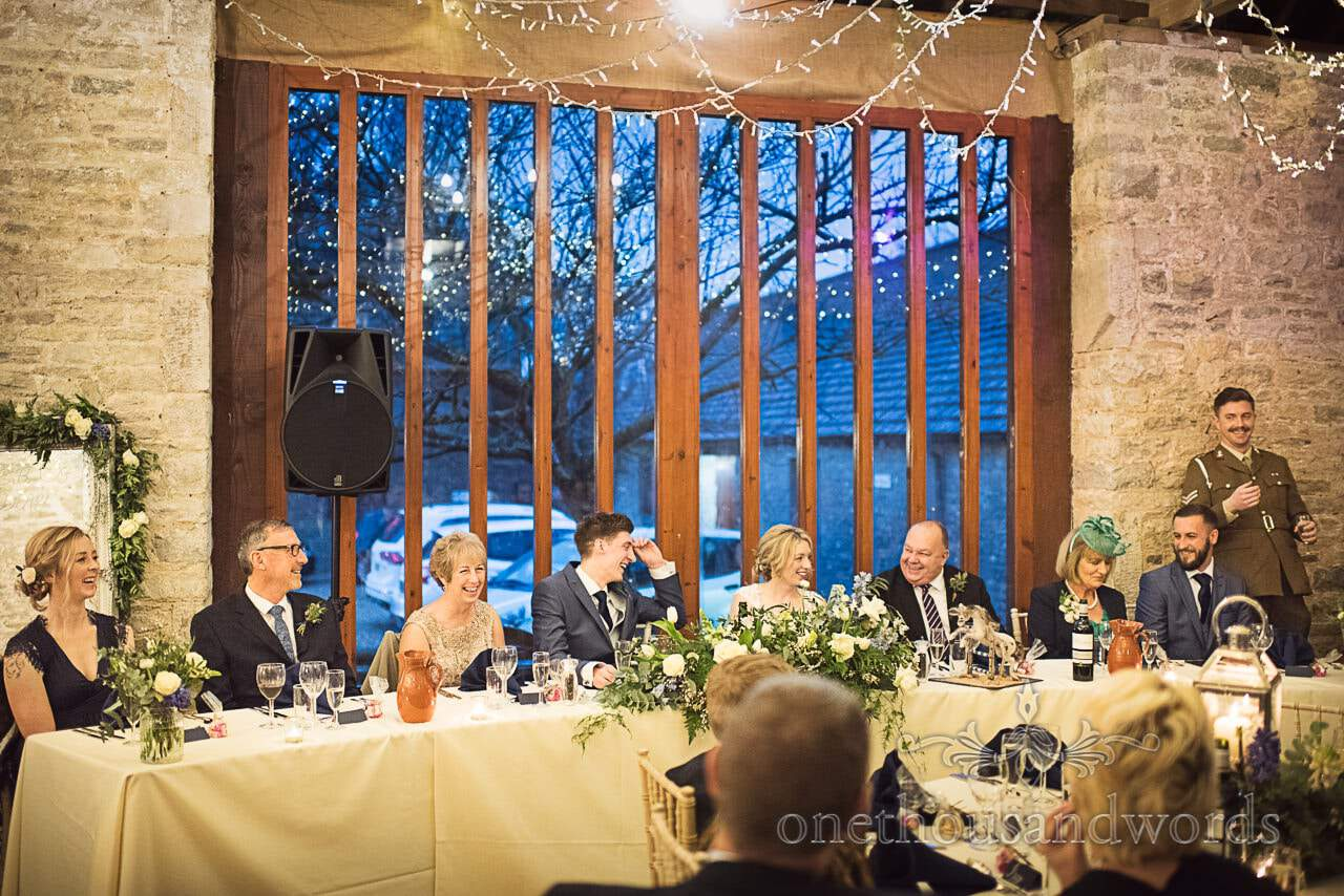 Top table at Kingston Country Courtyard wedding venue during speeches photo