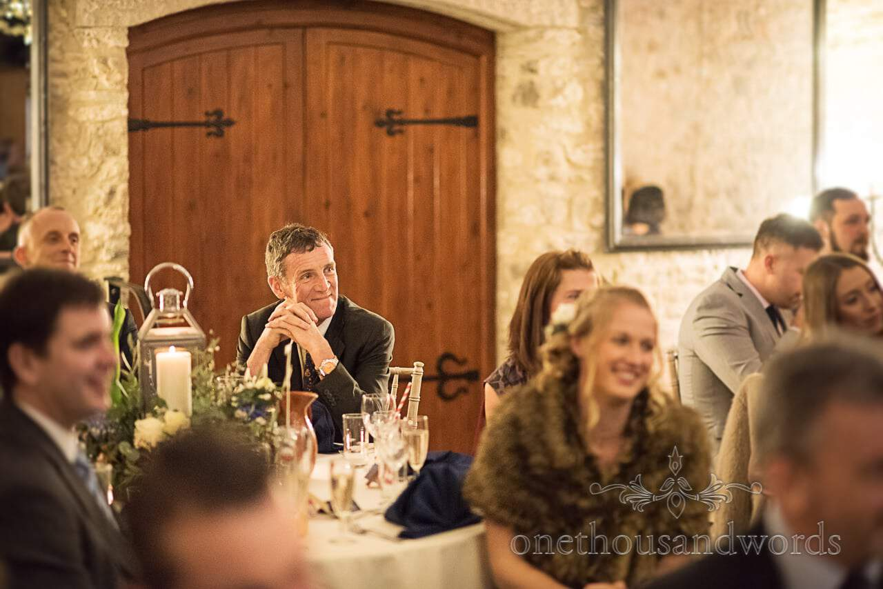 Wedding guest attentively listens to speeches at Kingston Country Courtyard
