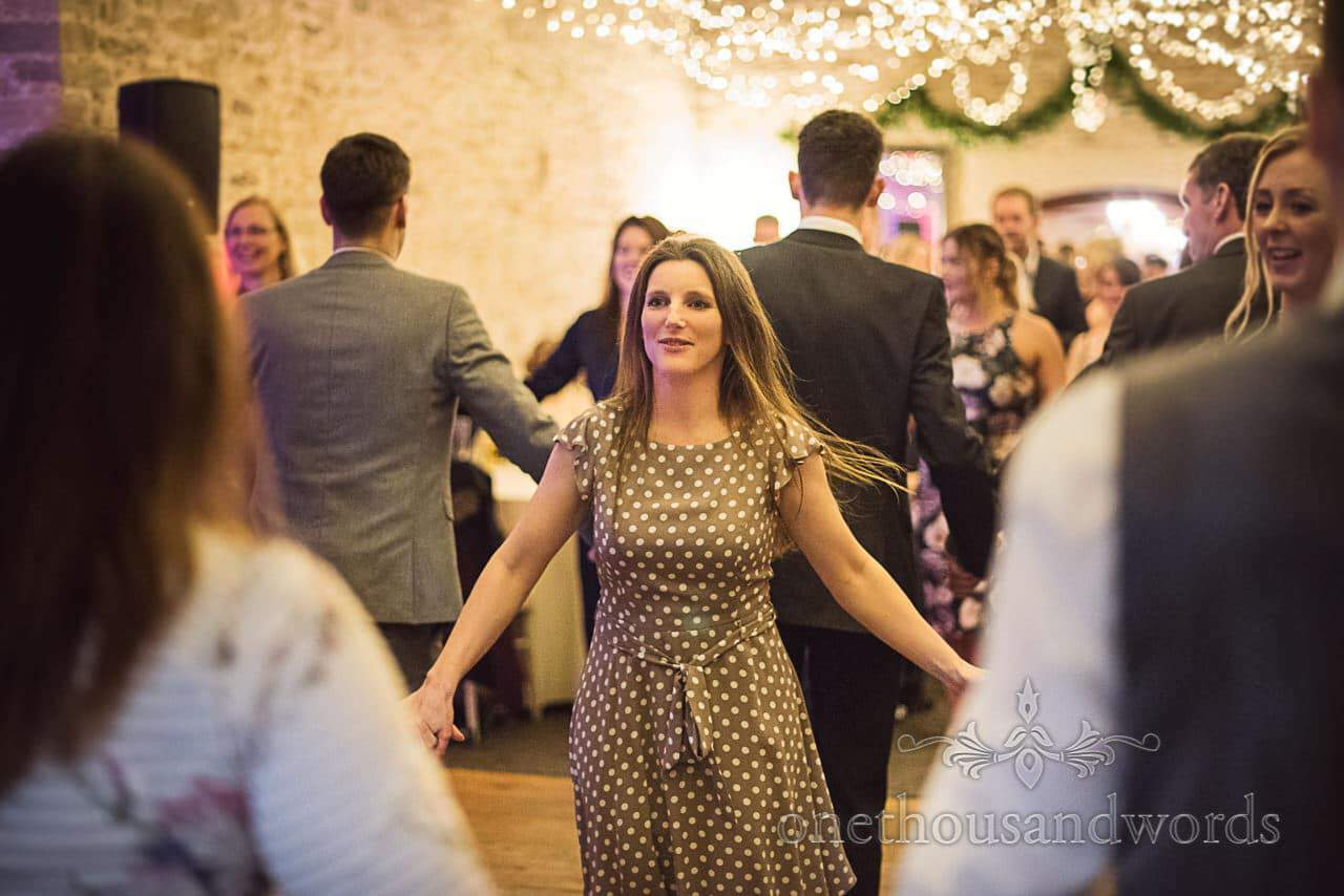 Wedding guest dancing at Kingston Country Courtyard wedding evening