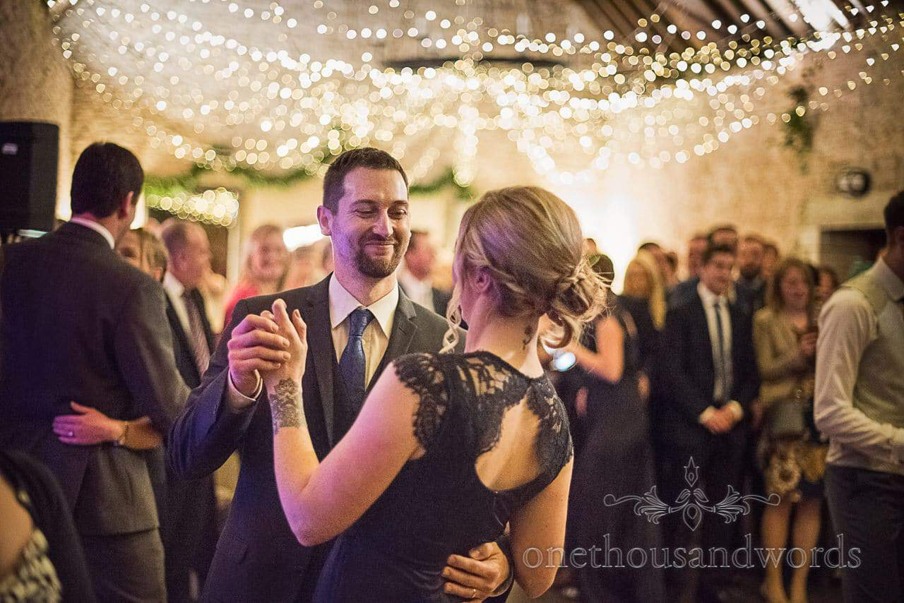 Wedding guests dancing at Kingston Country Courtyard evening reception