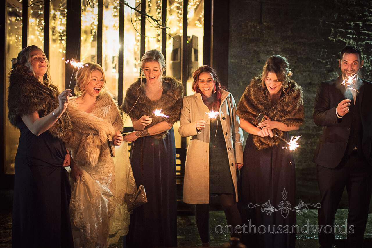 Wedding party enjoy wedding sparklers photograph at Kingston Country Courtyard