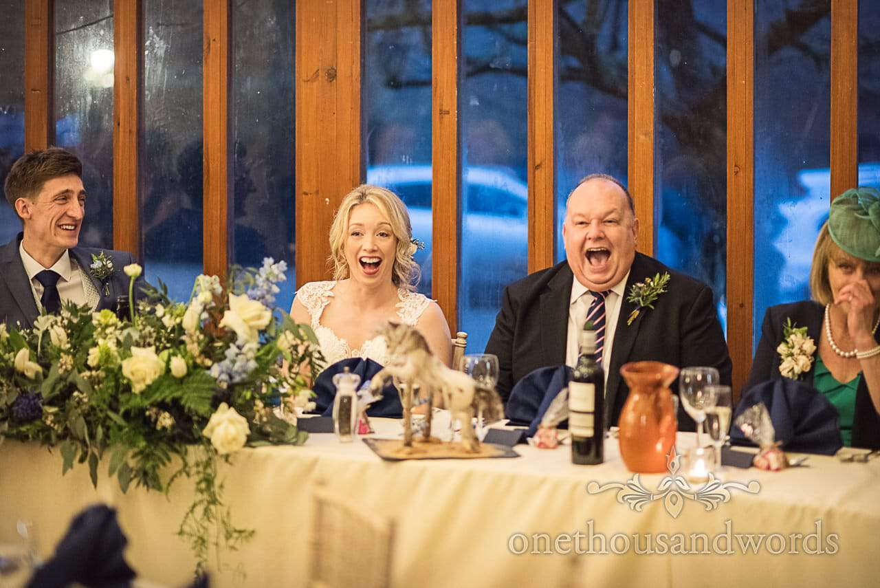 Wedding top table laughing at Kingston Country Courtyard wedding speeches