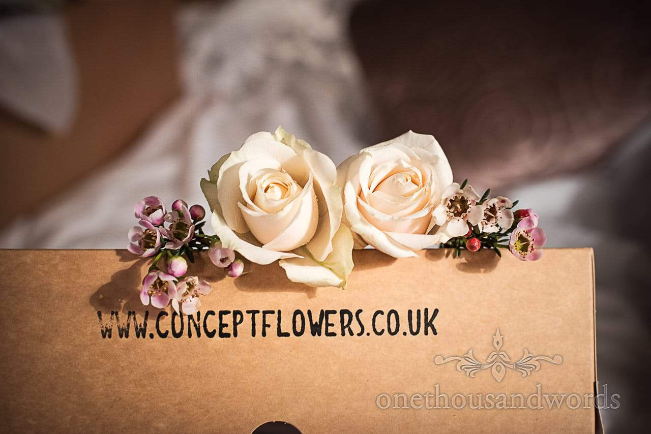 White wedding roses and small flowers for wedding hair styling by concept flowers