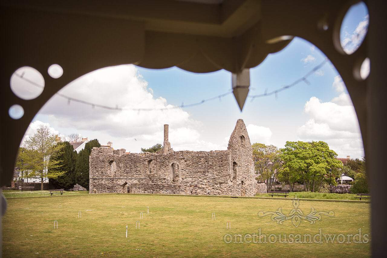 View of Ruins and bowling green with wedding croquet from Kings Arms Wedding Pavilion in Christchurch, Dorset