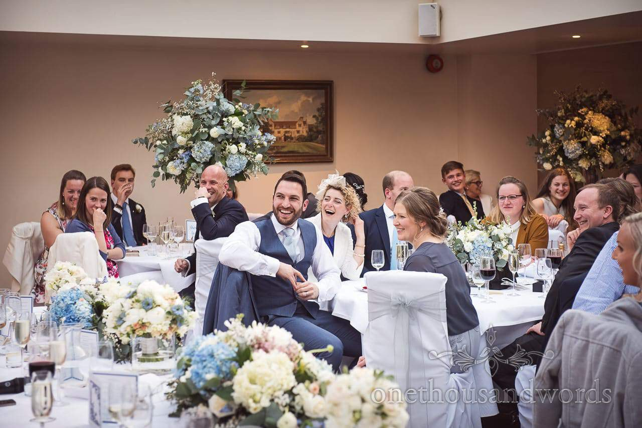 Wedding guests laughing at speeches at Athelhampton House Wedding