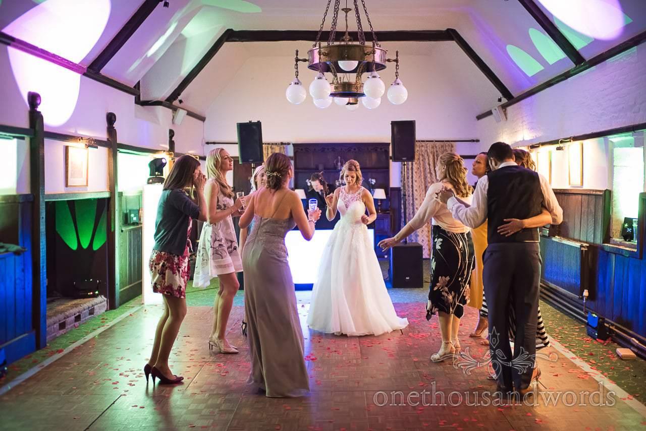 Athelhampton House Wedding disco dance floor with bride and friends dancing