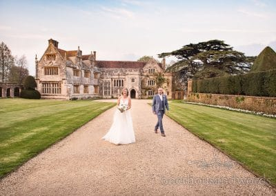 Athelhampton House Wedding venue with bride and groom at dusk