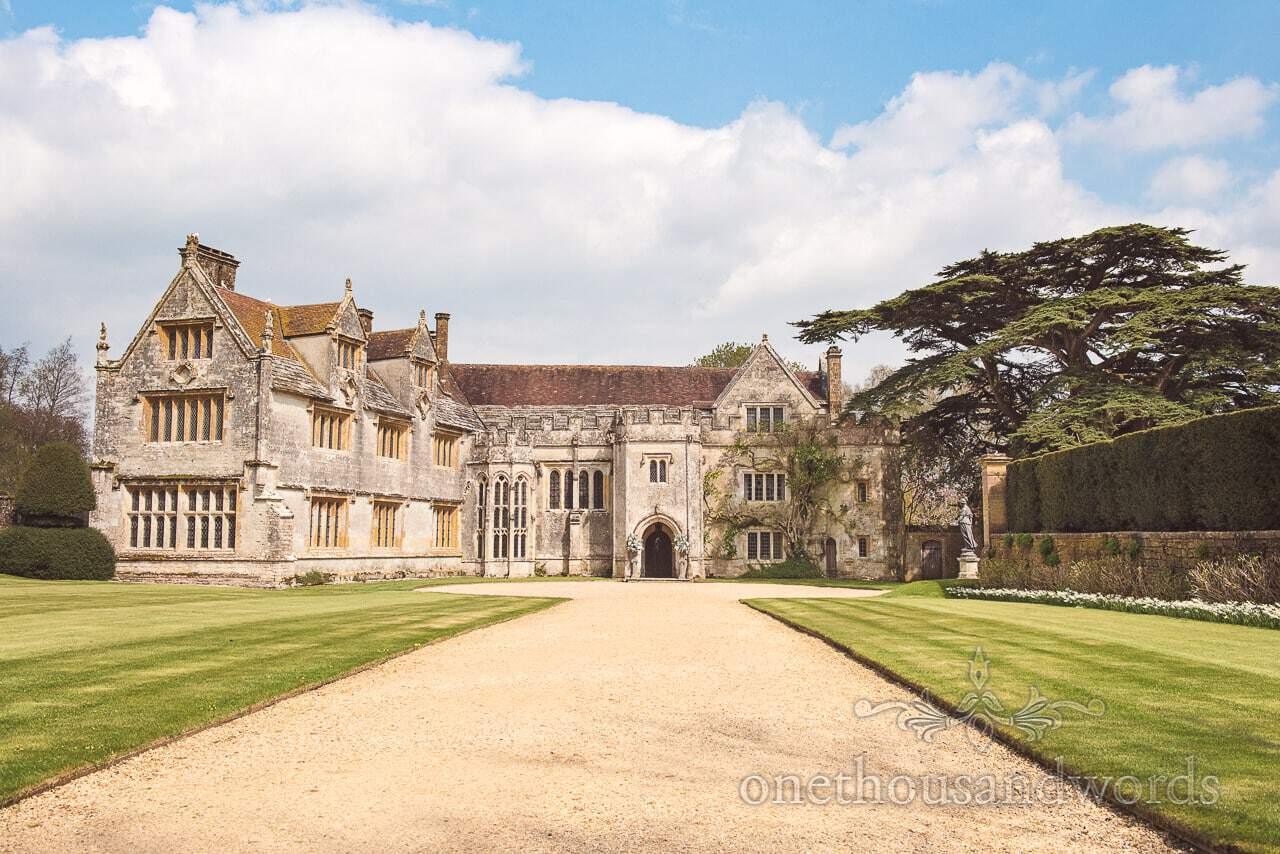 Athelhampton House Wedding venue in Dorset in sunshine blue sky