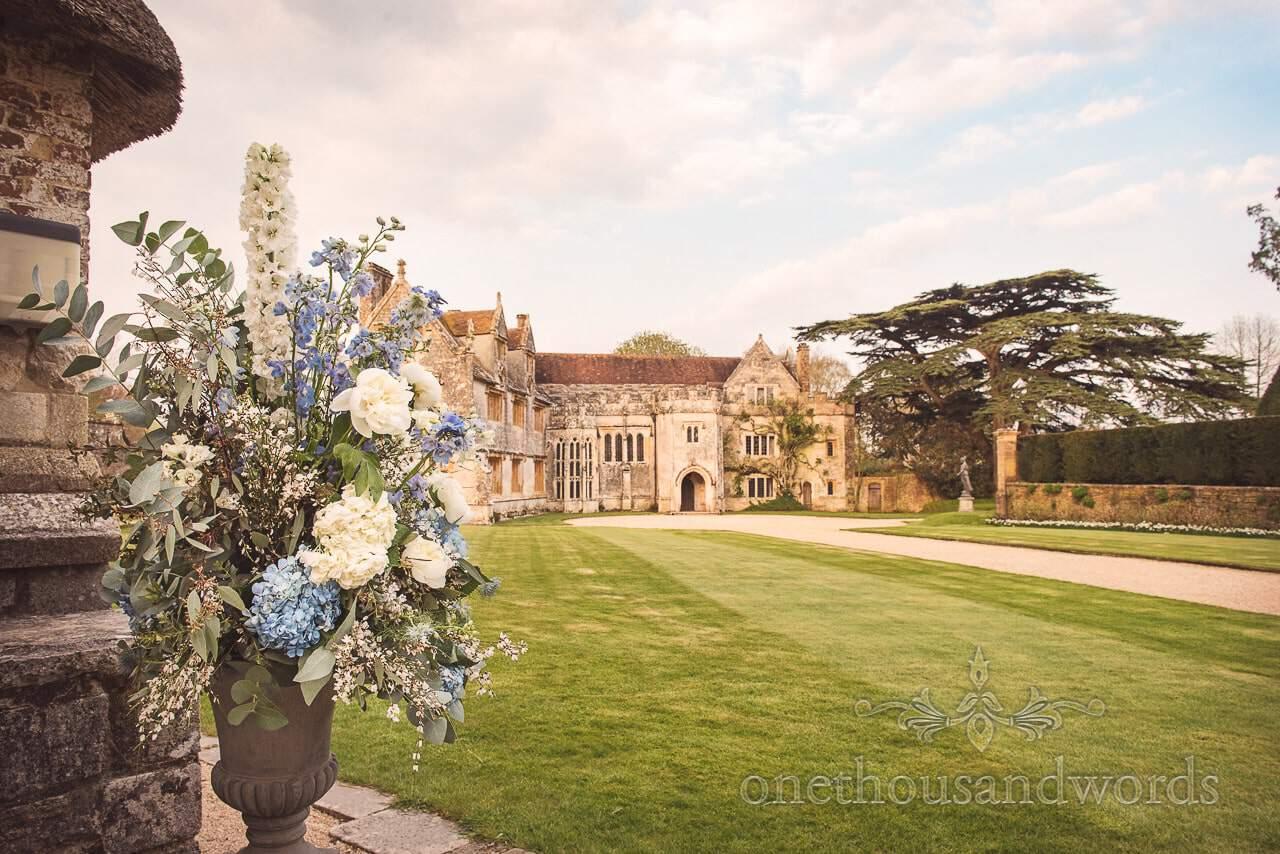 Athelhampton House Wedding venue photo with white blue wedding flower spray