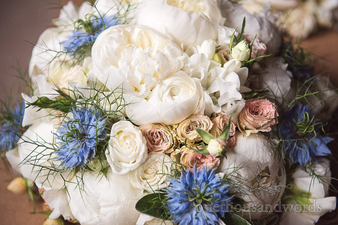 Beautiful pastel pink, white and blue wedding flower bouquet photograph