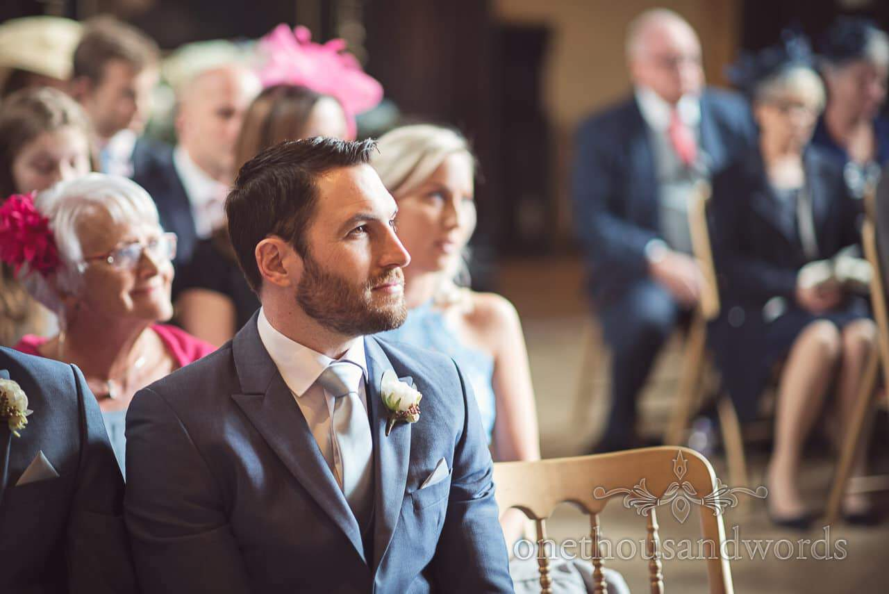 Best man in blue suit watches civil wedding ceremony at Athelhampton House