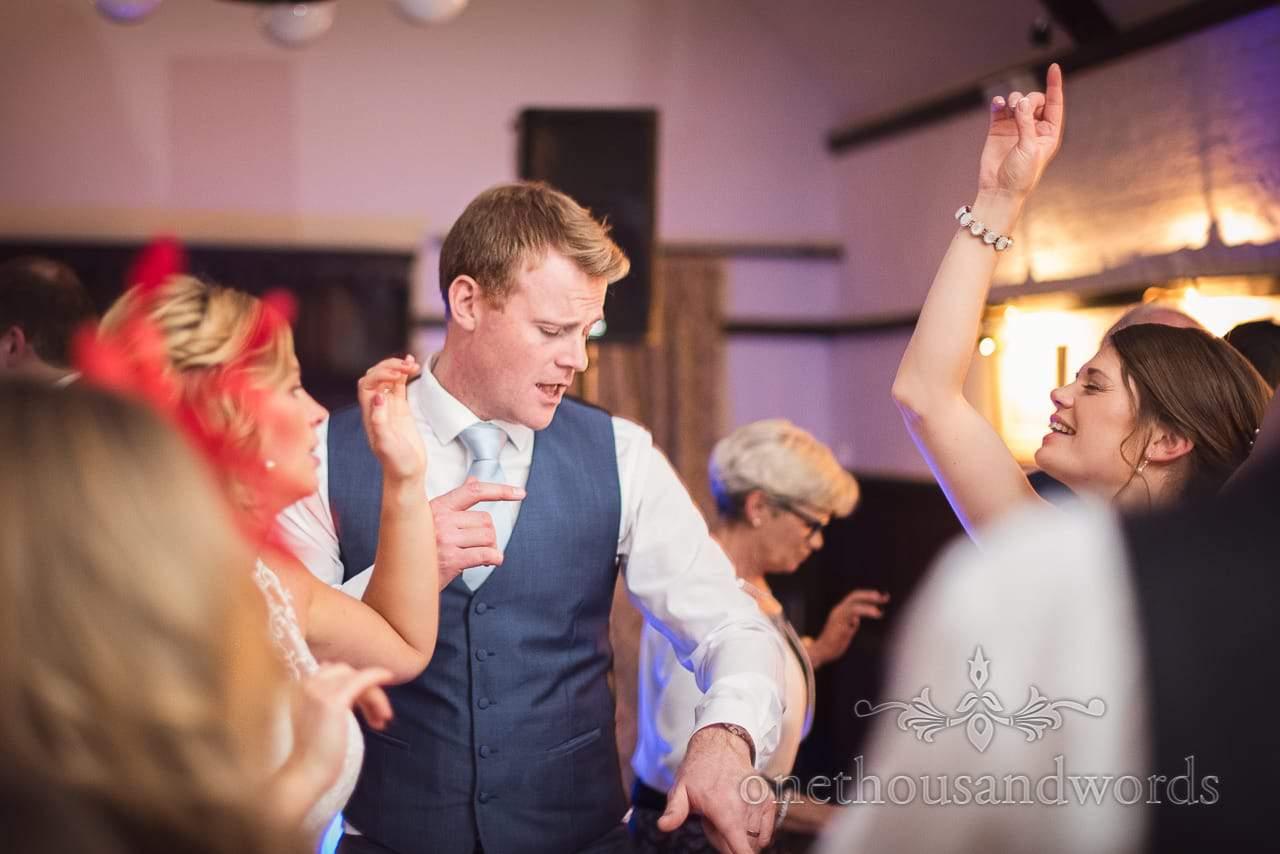 Best man in blue waistcoat dancing at Athelhampton House Wedding
