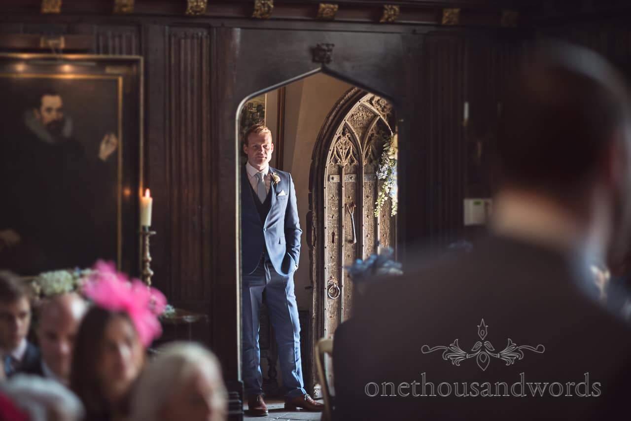 Best man waits in doorway at Athelhampton House Wedding photograph