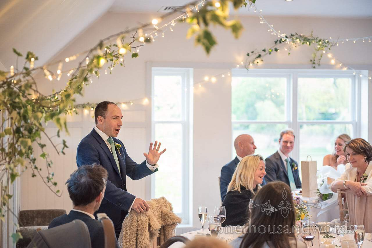 Best Mans Wedding Speech under fairy lights and ivy at Kings Arms Hotel Wedding breakfast photograph