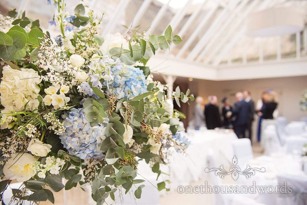 Blue and white wedding flower spray at Athelhampton House Wedding