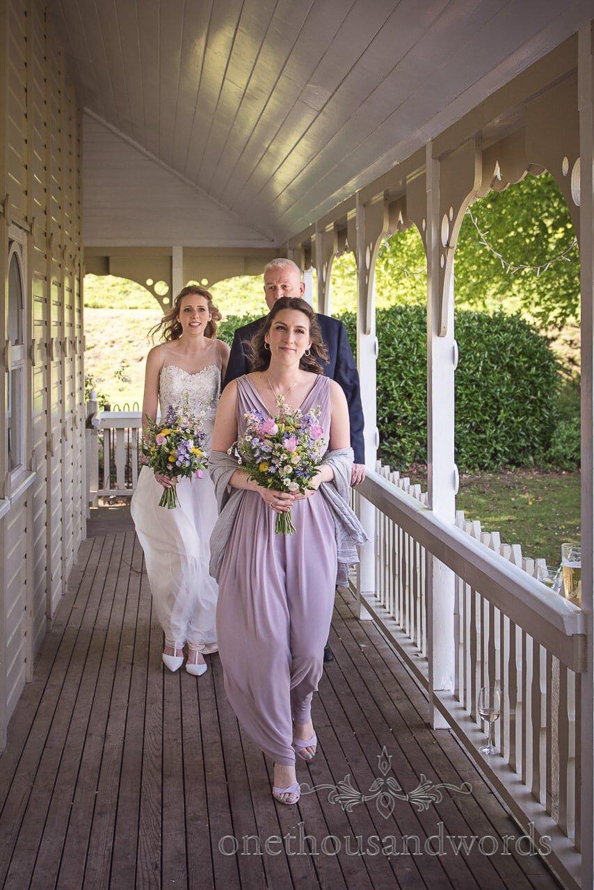 Bridal Party Walk along Kings Arms Pavilion Balcony at Christchurch Wedding Ceremony