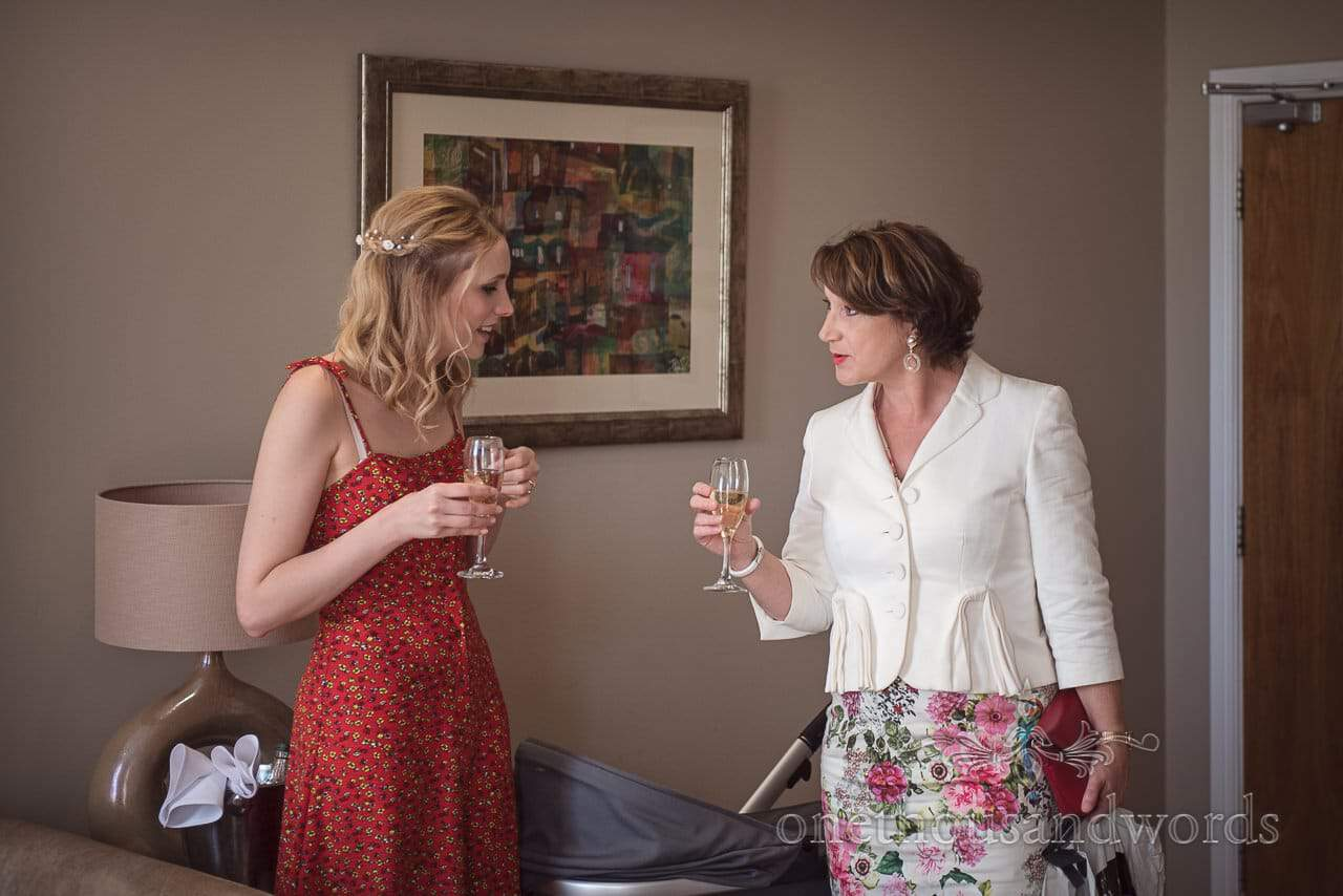 Bride Chats With Future Mother in Law with champagne glasses Documentary Wedding Preparation Photo