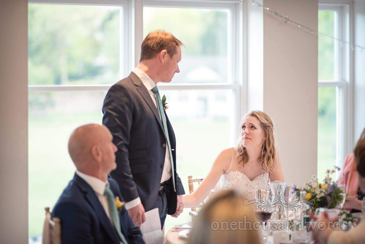 Bride looks into grooms eyes and Cries During Wedding Speech at Kings Arms wedding in Christchurch , Dorset