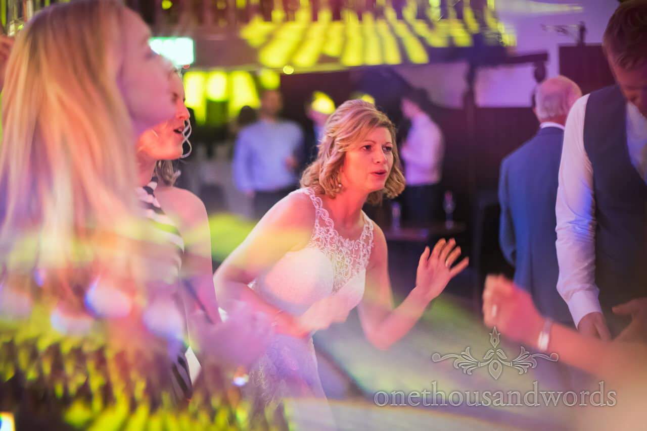 Bride dancing under disco lights at Athelhampton House Wedding