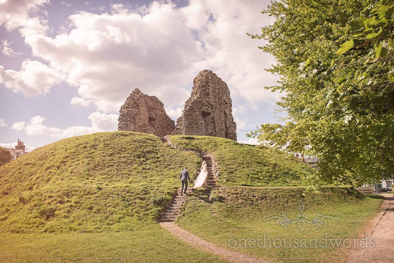 Bride and Groom at Christchurch Castle Ruins Kings Arms Wedding Photograph by Dorset Wedding Photographers one thousand words