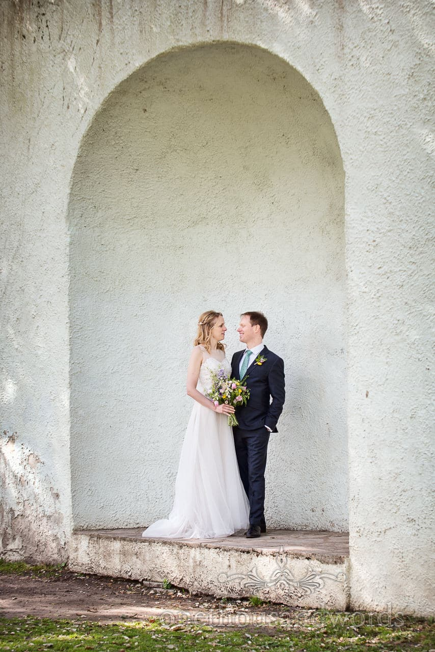 Bride and Groom Couple Photograph in Christchurch Priory Gardens mausoleum Niche