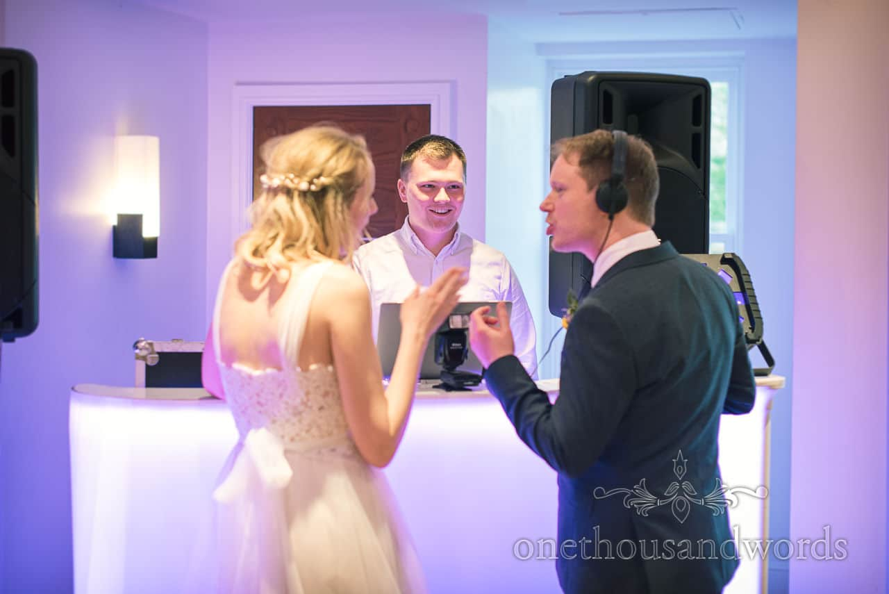 Wedding Photograph of Bride and Groom With DJ and Headphones at Kings Arms Wedding Evening Reception