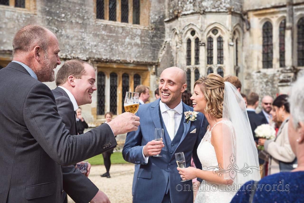 Bride and groom enjoying drinks reception at Athelhampton House