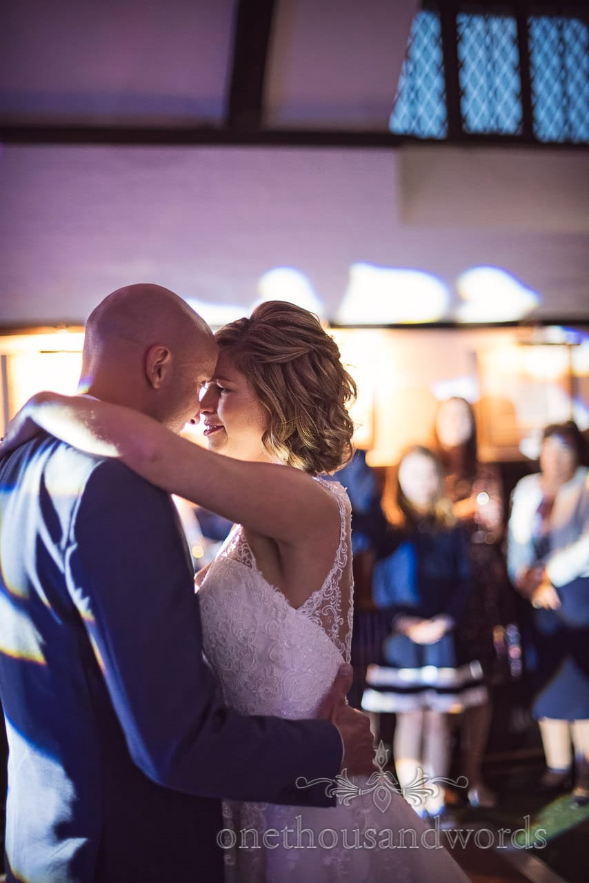 Bride and groom look into each others eyes during first dance