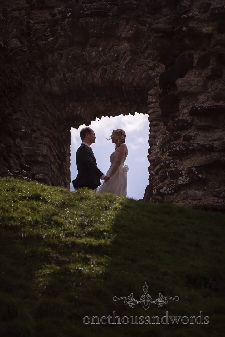 Bride and Groom Silhouette Wedding Photograph Framed by Christchurch Dorset Ruins Window