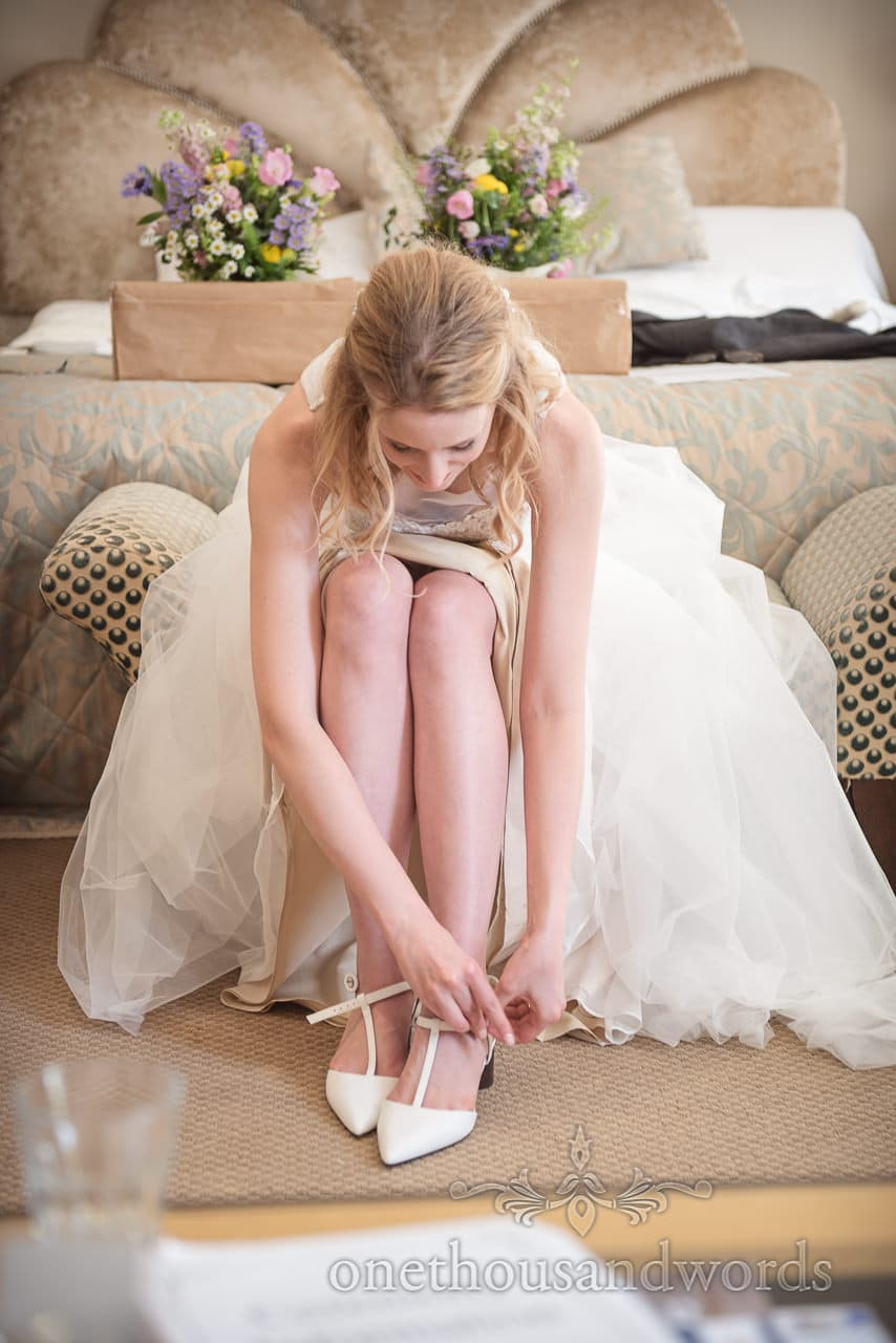 Bride with long legs Legs adds Wedding Shoes on Bed Bridal Preparation Photo at Kings Arms Wedding