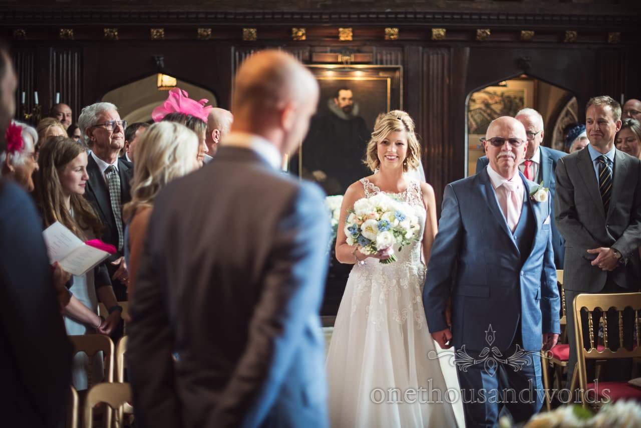 Bride walks down aisle at Athelhampton House wedding ceremony photograph