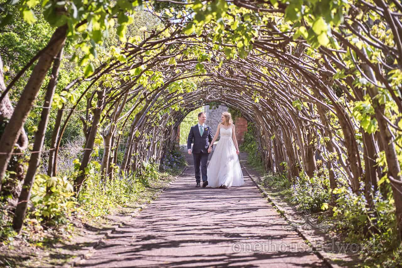 Christchurch Priory Gardens Wedding Tree Tunnel with Bride and Groom Kings Arms Wedding Photograph