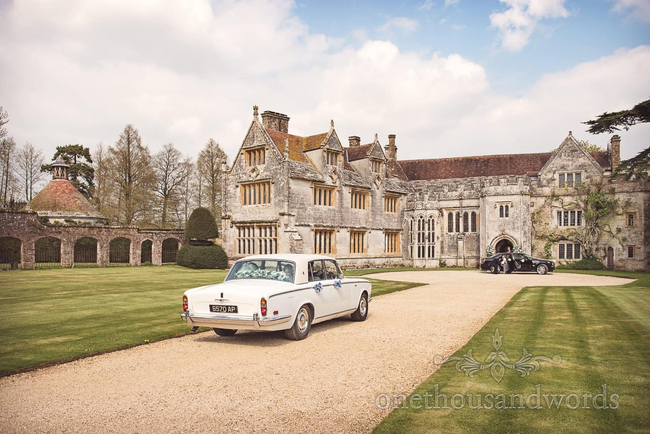 Classic Wedding Car arrives at Athelhampton House Wedding Venue