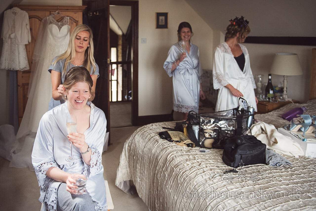 Documentary Bridal Preparation Photograph of Laughing Bridesmaid Hair Styling