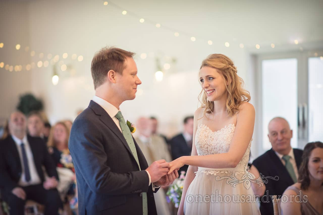 Exchange of Wedding Rings Documentary Photograph at Kings Arms Pavilion wedding Ceremony