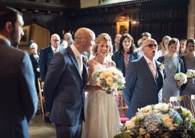 Father of bride makes bridal party laugh at Athelhampton House Wedding ceremony