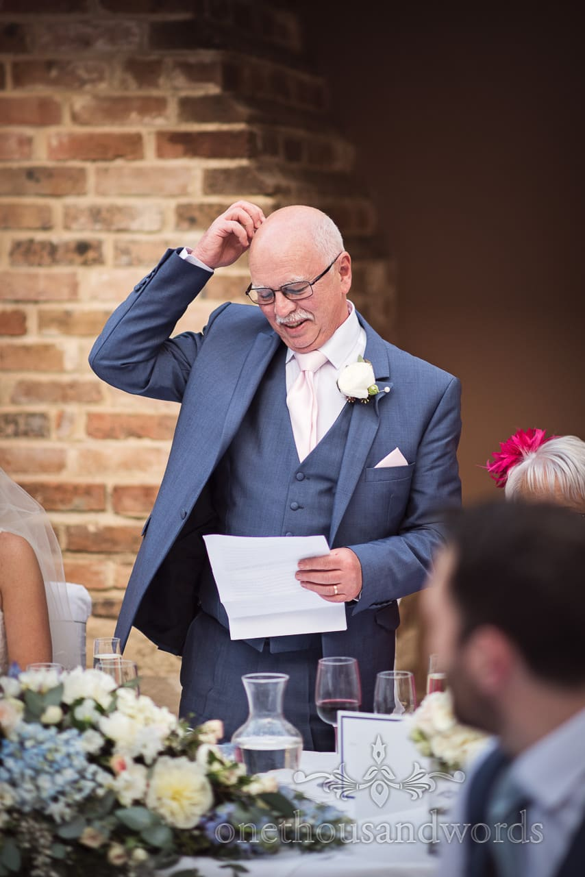 Father of the bride scratches head during wedding speech at Athelhampton House