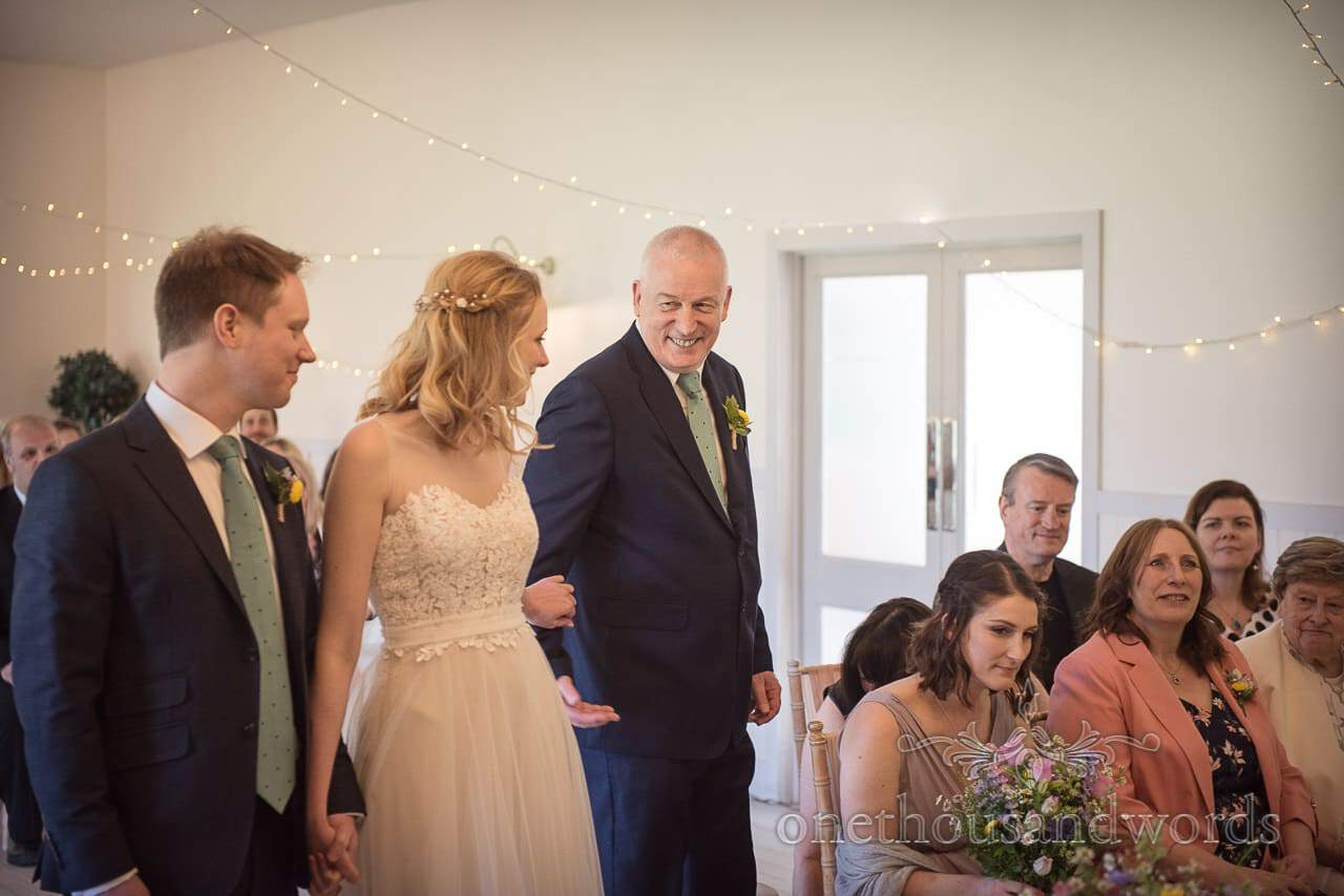 Father Smiles as he Gives Bride Away During Wedding Ceremony Photograph at Kings Arms Pavilion Wedding